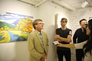 Edd discusses his work at the 188 Art exhibit, Shanghai